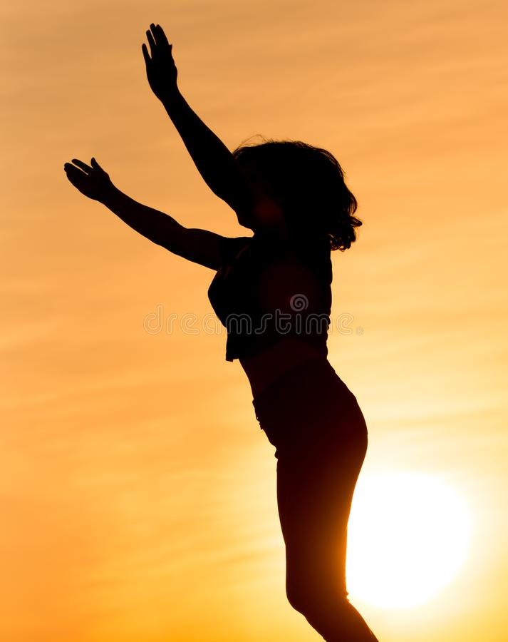 Silhouette of a girl in the sunset stock photos