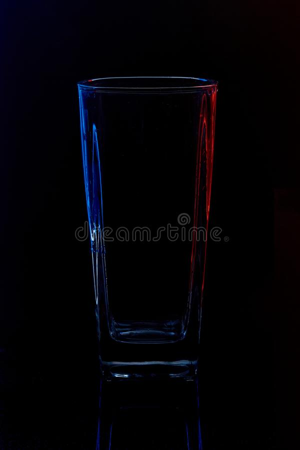 Silhouette of a glass with water on a black background royalty free stock photo