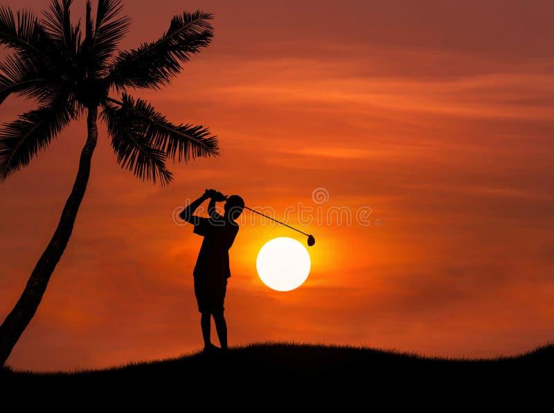 Silhouette golfer hitting golf shot on sunset stock photos