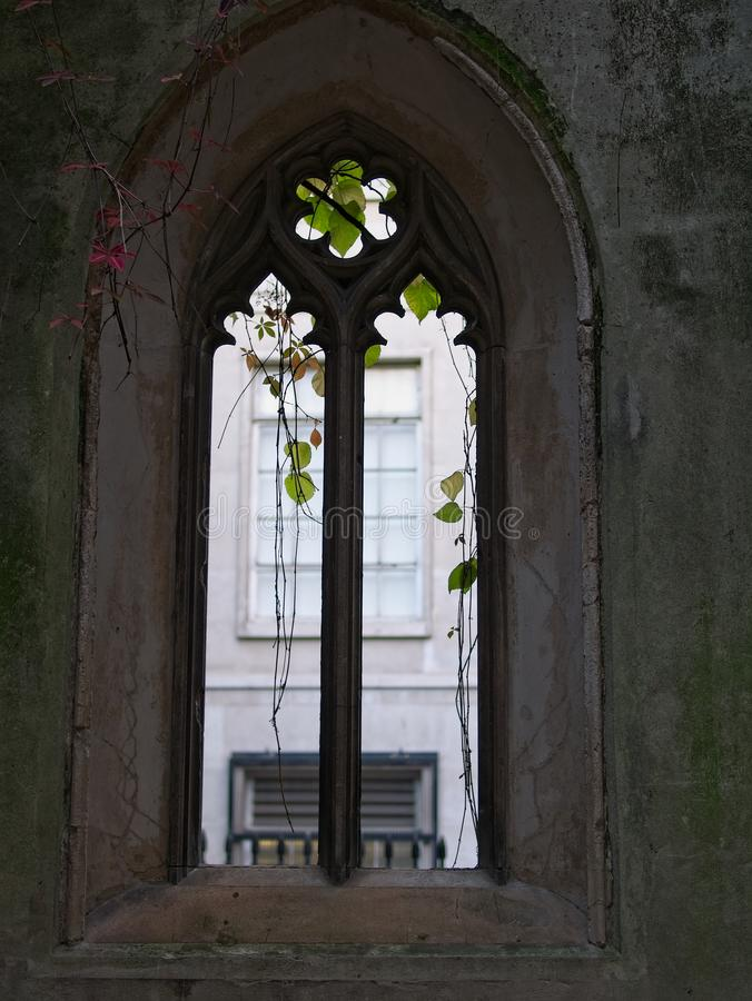 Silhouette of gothic window at St Dunstan in the East, London. Dark stone wall stock images