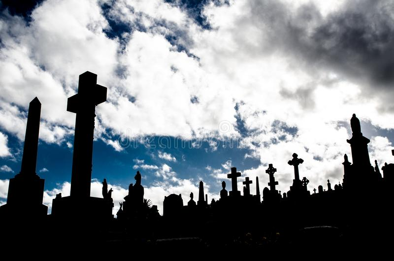 Silhouette of graveyard, the image shows many cross tombstone with dramatic cloudy sky. A Silhouette of graveyard, the image shows many cross tombstone with stock photo