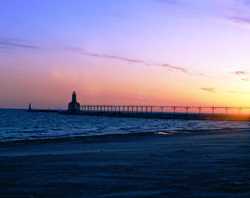 Silhouette of Gray Steel Bridge on Sea Shore during Sunset stock photo