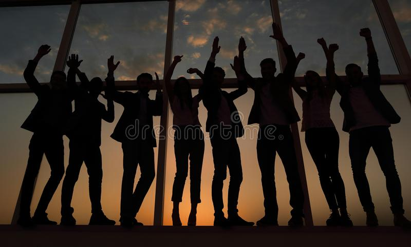 Silhouette of a group of business people raising their hand royalty free stock photography