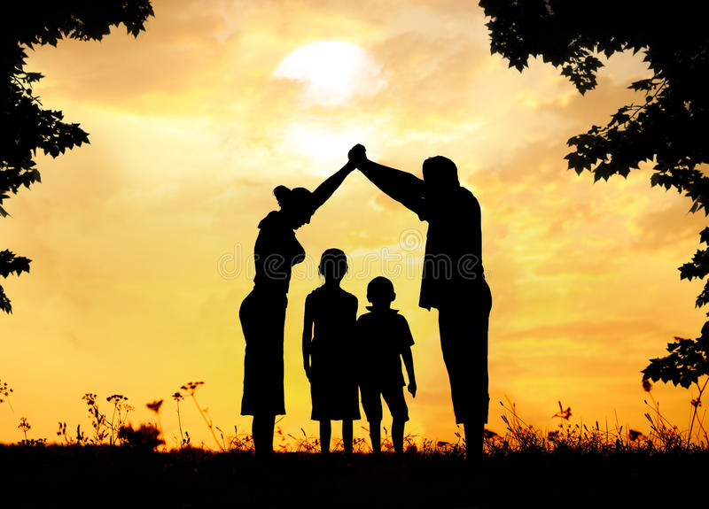 Silhouette, group of happy children playing on meadow. Sunset, summertime royalty free stock images