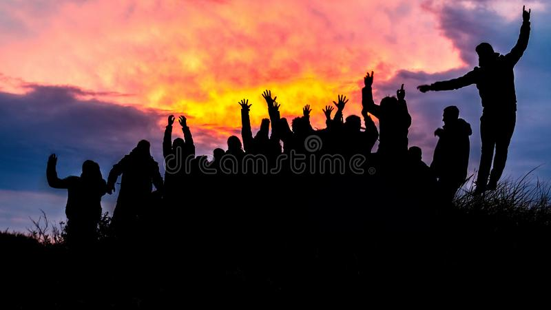 Silhouette, group of happy people jumping in sunset - image. Silhouette, group of happy people jumping in sunset royalty free stock images
