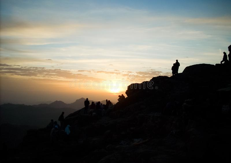 Silhouette of Group of Person Hiking on the Mountain stock photos