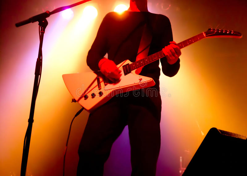 Silhouette of guitar player stock photo
