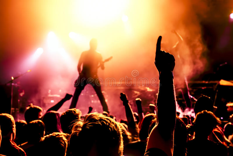 Silhouette of guitar player in action on stage. In front of concert crowd royalty free stock photos