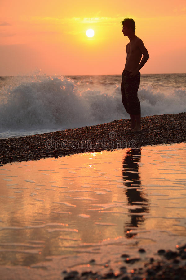 Download Silhouette Guy On Sunset Wavy Beach Stock Photo - Image of beauty, outdoors: 12262904