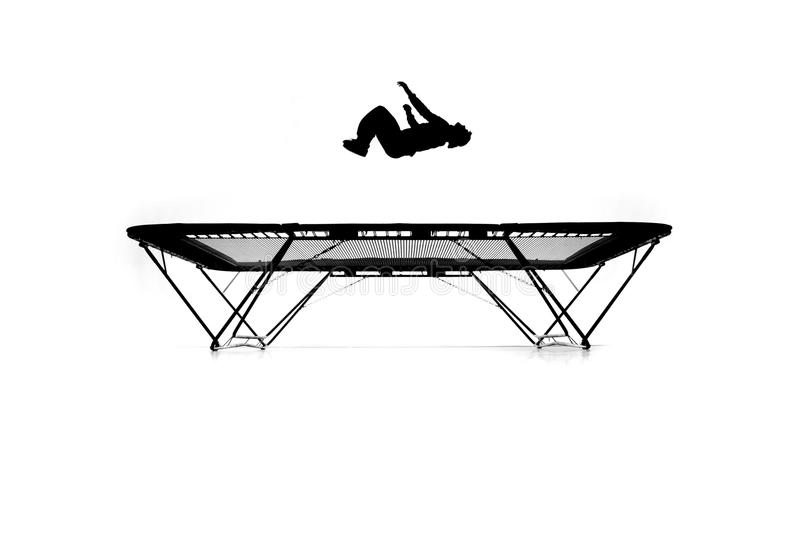 Silhouette of gymnast on trampoline stock image