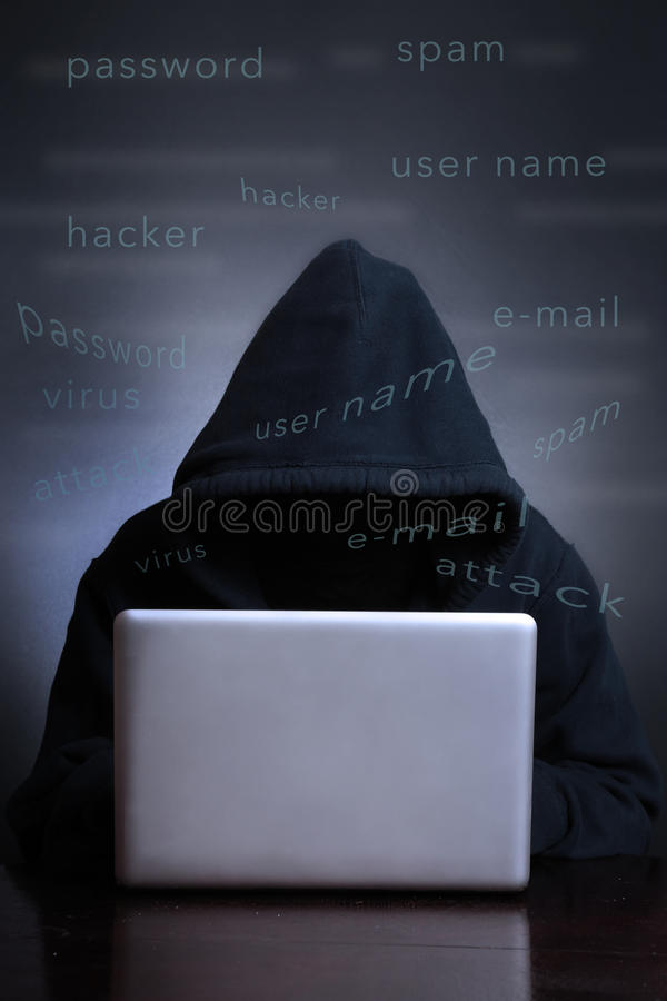 Silhouette of a hacker looking in monitor. Computer hacker - Male thief stealing data from laptop royalty free stock photography