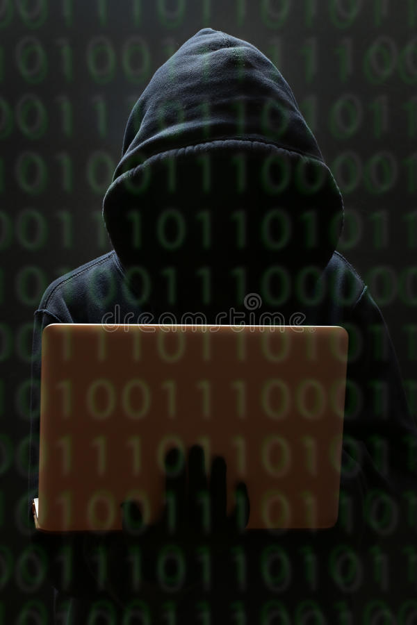 Silhouette of a hacker looking in monitor stock photos