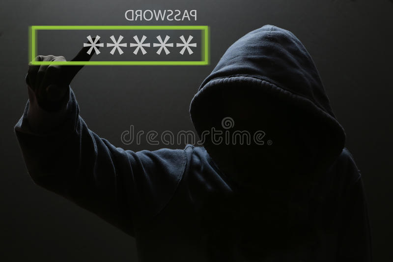 Silhouette of a hacker stock photography