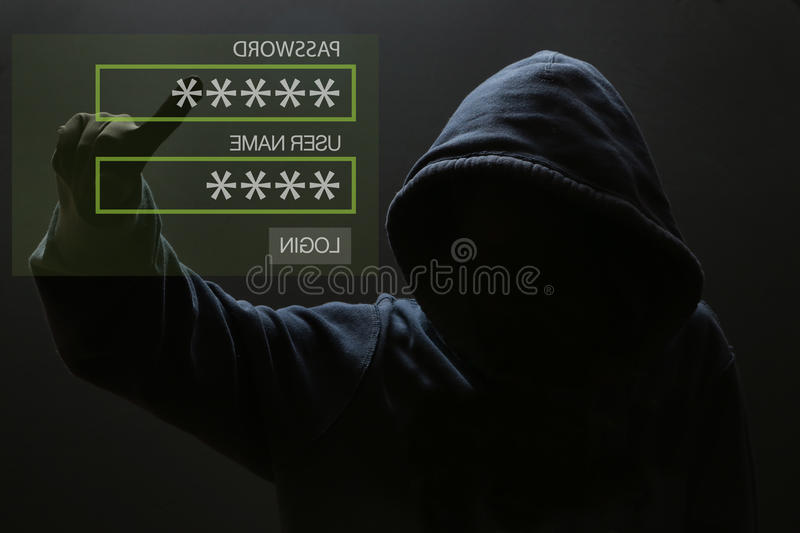 Silhouette of a hacker royalty free stock photo