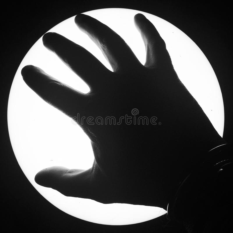 Silhouette of a hand royalty free stock photos