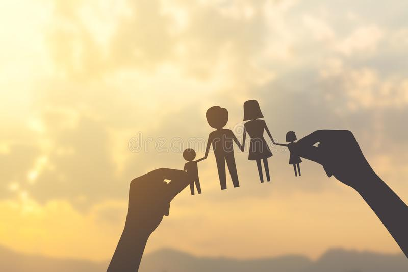 Silhouette hand holding paper of family. With sunrise background royalty free stock image