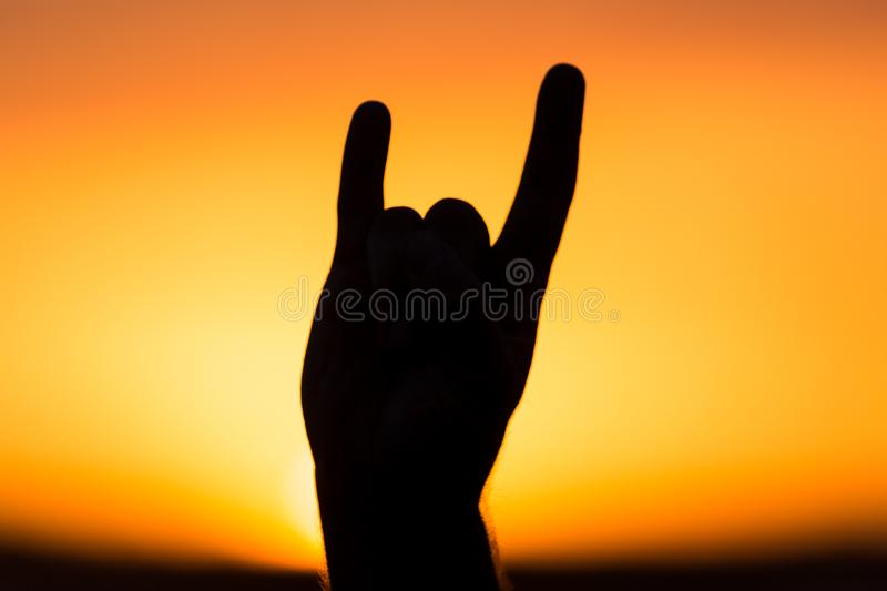 Silhouette of hand at sunset royalty free stock photos