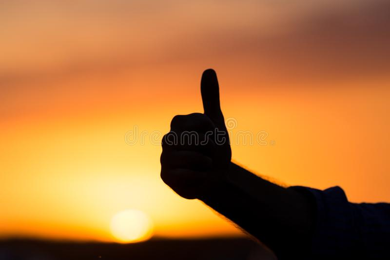 Silhouette of hand at sunset royalty free stock image