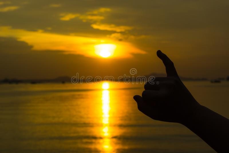 Silhouette of hand to pinky promise, pinky swear in front of the sun during sunset time. Love and valentine concept royalty free stock images