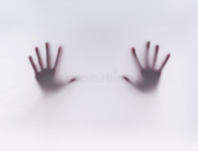 Silhouette of hands on a misty background. Silhouette of female hands on a gray misty background royalty free stock photo