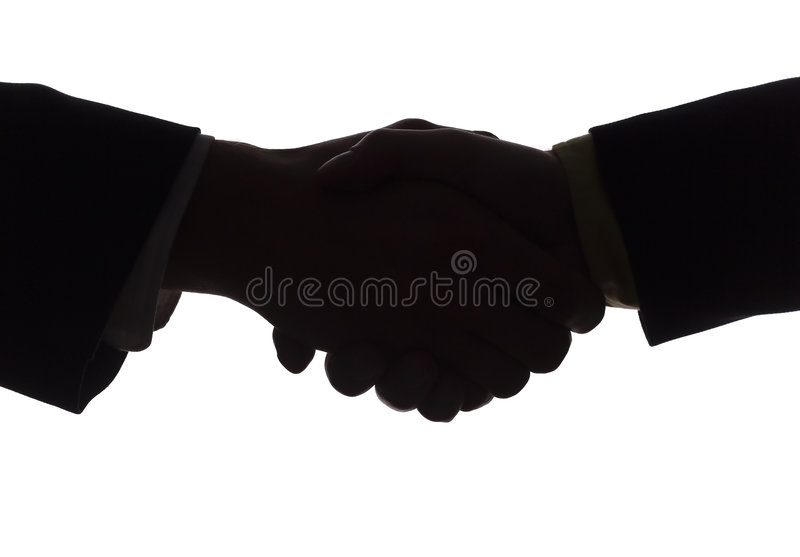Silhouette of handshake stock photo