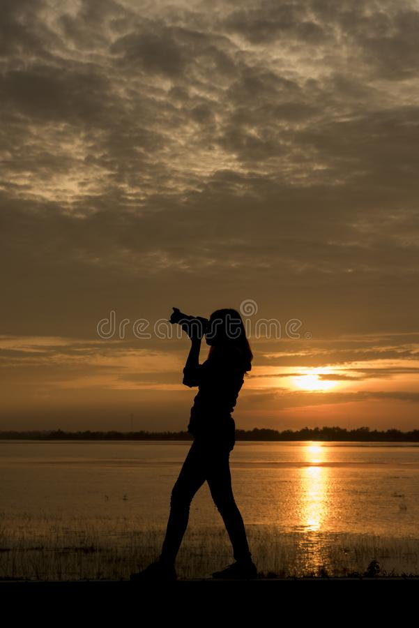 Silhouette Handsome Photographer take a photo with professional camera royalty free stock photos