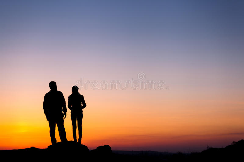 Silhouette of happiness family against beautiful colorful sky. S. Ummer Sunset. Landscape royalty free stock images