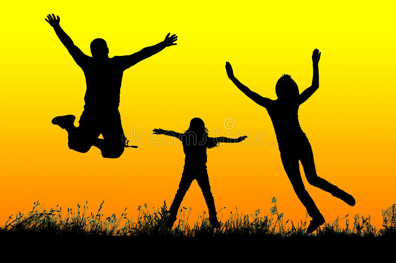 Silhouette of a happy active family jumping at sunset royalty free stock photography