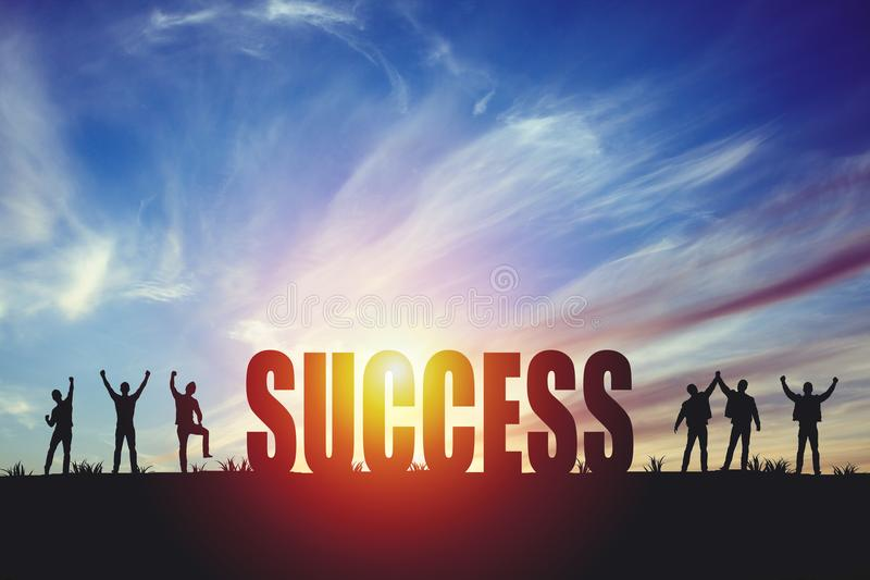 Silhouette of happy business team making high hands in sunset sky background royalty free stock photography
