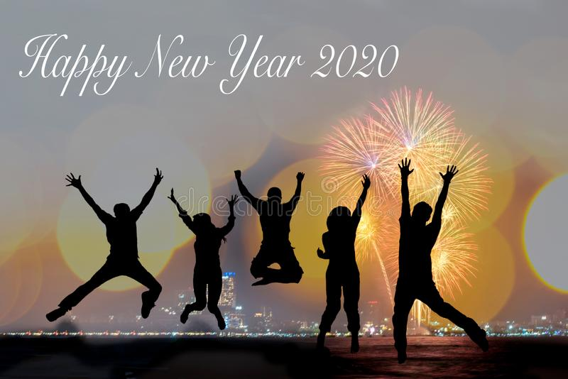 Silhouette happy business teamwork jumping and cheering crowd fireworks congratulation graduation in Happy New year 2020. Freedom royalty free stock photography