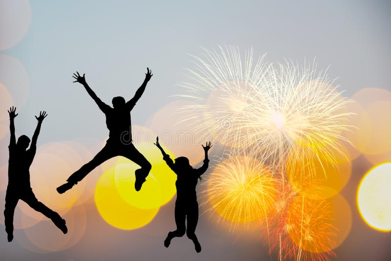 Silhouette happy business teamwork jumping and cheering crowd fireworks congratulation graduation in Happy New year 2020. Freedom royalty free stock photo