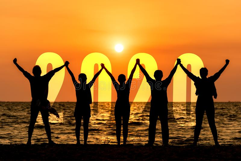 Silhouette happy business teamwork raise hands congratulation and celebrate in Happy New year 2020 for change new life future conc. Ept. Freedom lifestyle group royalty free stock image