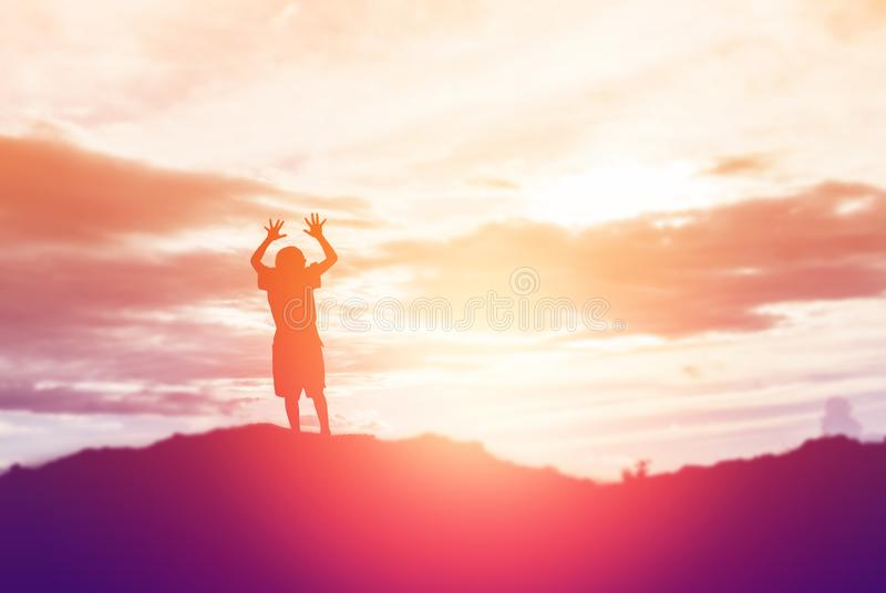 Silhouette of a happy children and happy time sunset royalty free stock images