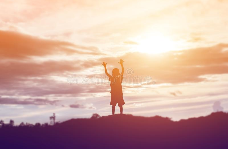 Silhouette of a happy children and happy time sunset stock photos