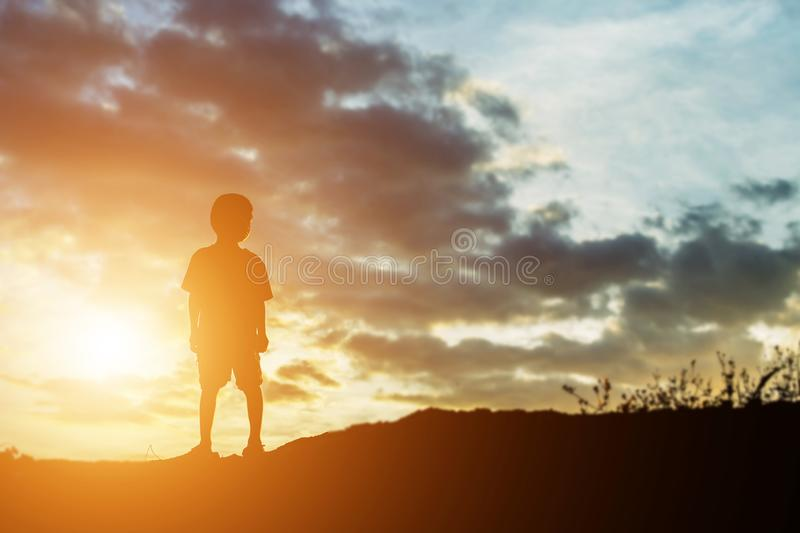 Silhouette of a happy children and happy time sunset stock photo