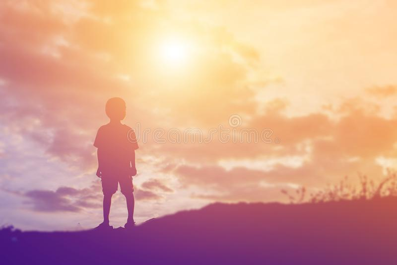 Silhouette of a happy children and happy time sunset stock photography