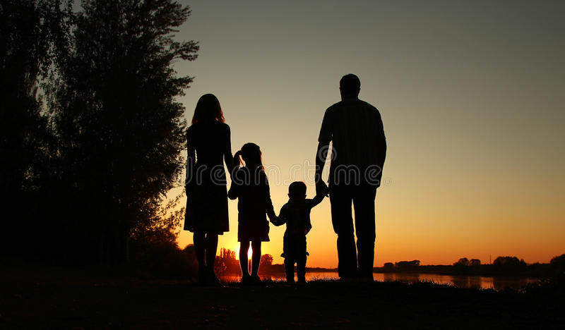 Silhouette of a happy family with children. A silhouette of a happy family with children stock images