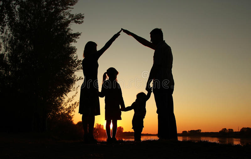 Silhouette of a happy family with children. A silhouette of a happy family with children stock photo