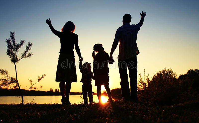 Silhouette of a happy family. With children royalty free stock photo