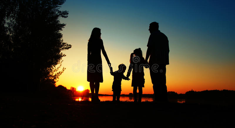 Silhouette of a happy family. With children stock image
