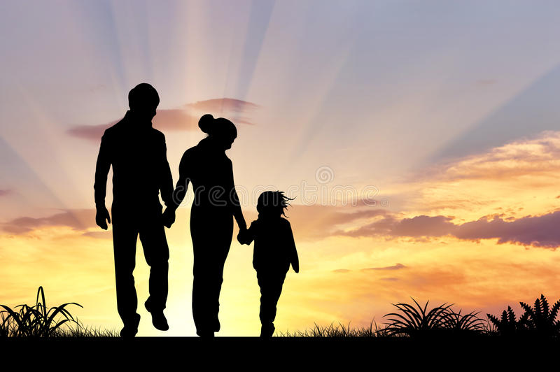 Silhouette of a happy family. With children on the background of a sunset stock image