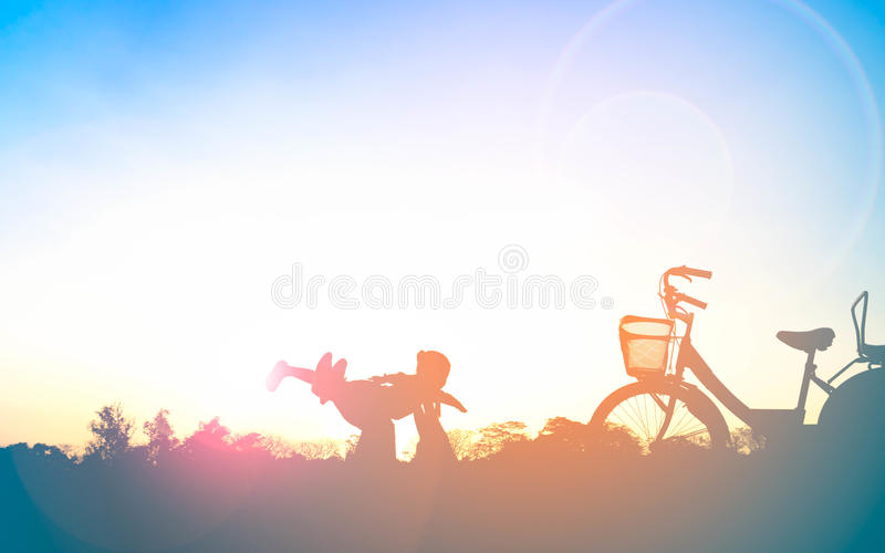 Silhouette of happy family mother and child playing outdoors royalty free stock photos