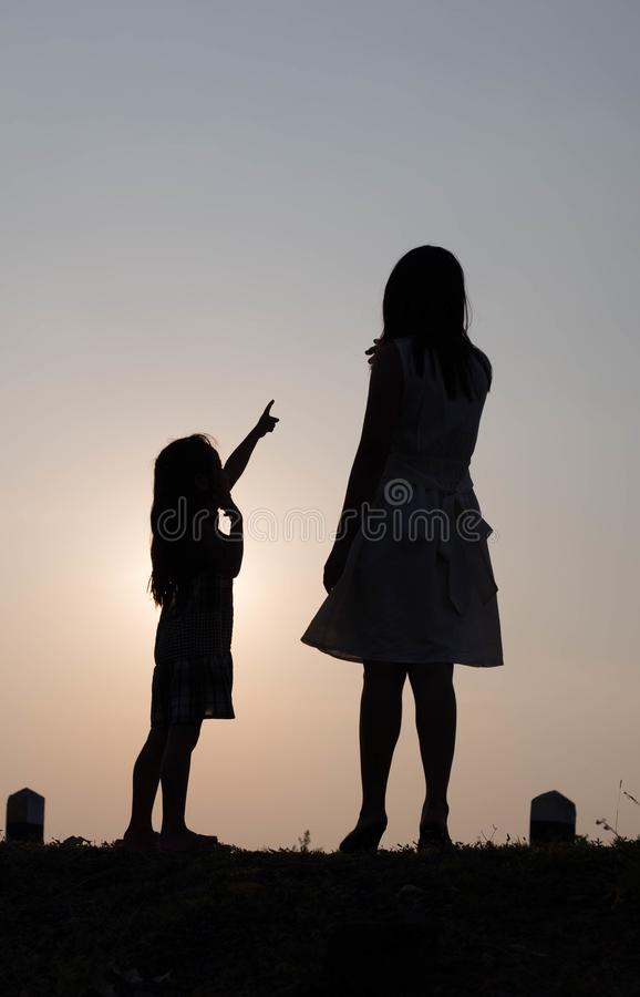 Silhouette happy family at sunset, parents, children Love affair concept Holiday hobby Family activities. Silhouette happy family at sunset, children Love affair stock photo