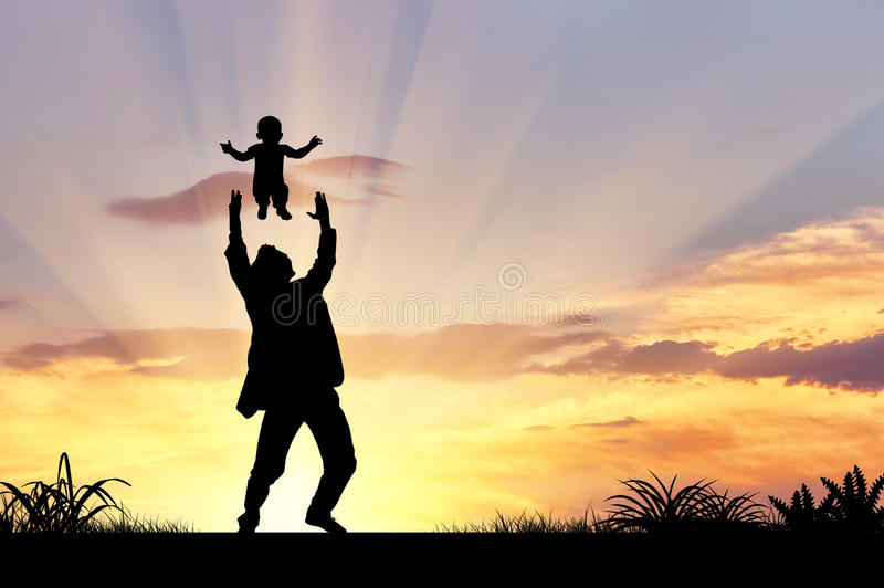 Silhouette of a happy father and child stock photo