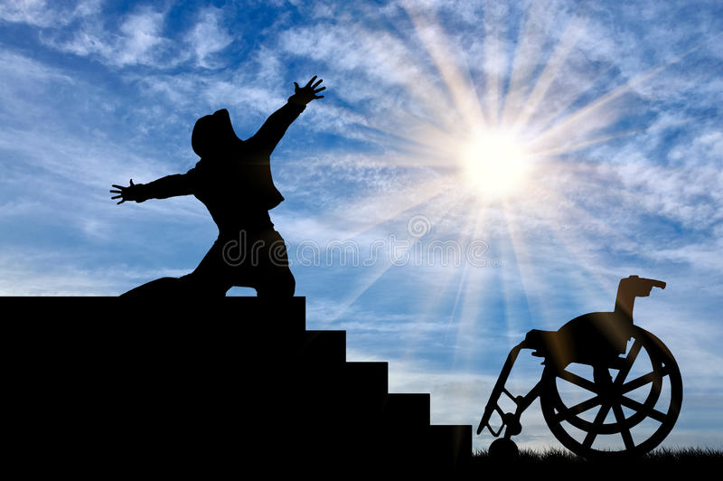 Silhouette happy invalid. Concept of disability and positive. Silhouette of disabled person to experience happiness at the top of the stairs daytime stock photos