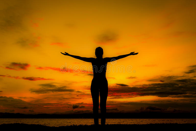 Silhouette happy woman on the beach at sunset. Vintage tone stock images