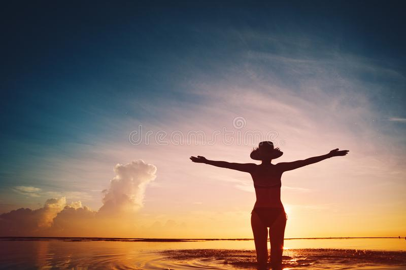 Silhouette of happy woman in the ocean royalty free stock images