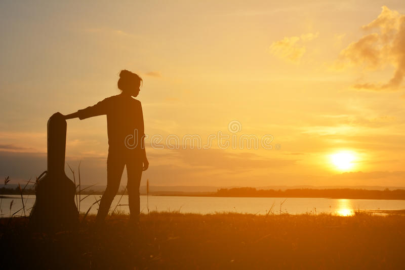 Silhouette of happy women with bicycle royalty free stock photos