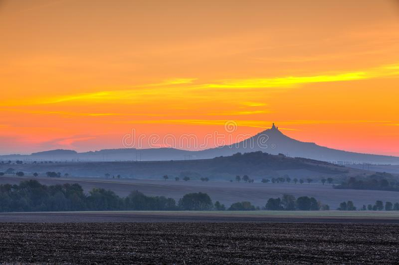 The silhouette of Hazmburk Castle at sunrise.Czech Republic. royalty free stock images