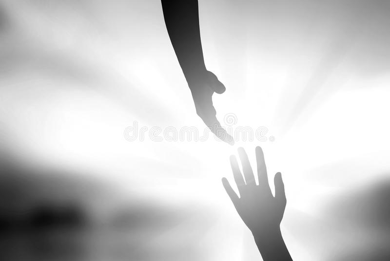 Silhouette of helping hand concept and international day of peace. Hands of Christ Jesus are stretching out to save the world in sunset background stock images